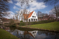 Brugge - medieval house over a canal in Bruges, Belgium Stock Image