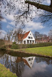 Brugge - medieval house over a canal in Bruges, Belgium Stock Photos