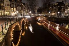 Bruggen bij de kanalenintersectio van Leidsegracht en Keizersgracht- Stock Afbeelding
