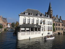 Brugges, Belgium. Tourists in canal boats in Bruges, Belgium Royalty Free Stock Image