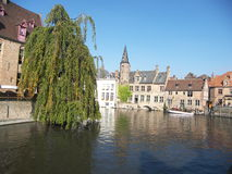 Brugges, Belgium. Tourists in canal boats in Bruges, Belgium Royalty Free Stock Photography