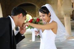 Bruid en Bruidegom bij Huwelijk Stock Afbeeldingen