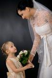 Bruid en bruidsmeisje stock afbeelding