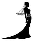 Bruid in het silhouet van de huwelijkskleding Stock Foto