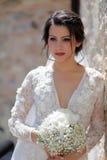 Bruid met bruids bouque stock foto's