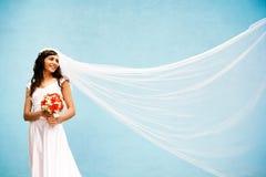 Bruid met een huwelijksboeket Royalty-vrije Stock Afbeelding