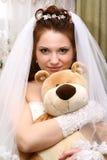 Bruid met stuk speelgoed Stock Afbeelding