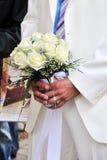 Bruidegom en bloemen Stock Afbeeldingen