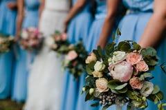 Bruidsmeisjes in blauw Stock Afbeelding