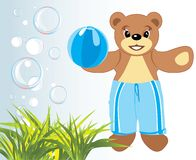 Bruin with ball among grass and bubbles Royalty Free Stock Images