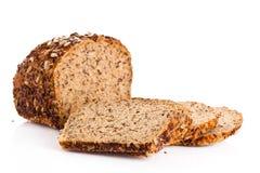 Bruin die zaad biobread op wit gezond voedsel wordt geïsoleerd als achtergrond Stock Foto's