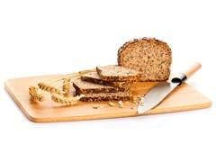 Bruin die zaad biobread op witte gezonde voeding wordt geïsoleerd als achtergrond Stock Fotografie