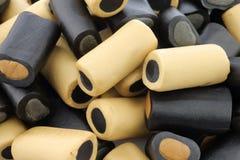 Bruin en zwart zoethout Stock Foto
