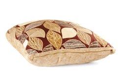 Bruin hoofdkussen met bladerenpatroon Royalty-vrije Stock Afbeelding