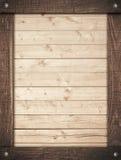 Bruin houten die kader op lichte muurplanken wordt geschroeft Stock Afbeelding