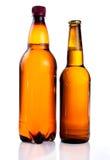 Bruin plastic fles en glas Stock Foto's