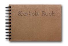 Bruin schetsboek dat op witte achtergrond wordt geïsoleerde Royalty-vrije Stock Afbeeldingen