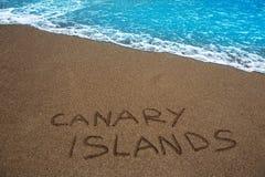 Bruin strandzand geschreven woordCanarische Eilanden Royalty-vrije Stock Foto