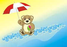 Bruin with umbrella and ball Royalty Free Stock Photography