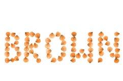 BRUIN Word geschikt van echte droog nam bloemblaadjes toe Royalty-vrije Stock Fotografie