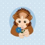 Bruine aap die een blauwe bloem houden Stock Afbeelding