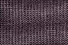 Bruine achtergrond met gevlecht geruit patroon, close-up Textuur van de wevende stof, macro Stock Fotografie