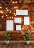 Bruine bakstenen muurachtergrond die met de verlichting van de takglimworm, lege fotokaders en bladerenvaas wordt verfraaid voor  royalty-vrije illustratie