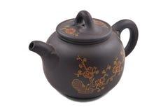 Bruine ceramische theepot met gouden bloemenornament Royalty-vrije Stock Fotografie