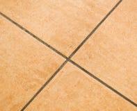 Bruine ceramische vloertegels Stock Foto's