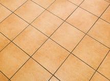 Bruine ceramische vloertegels Stock Foto
