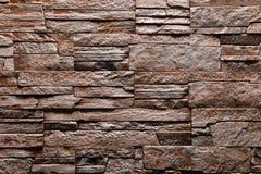 Bruine de textuur van de Steenmuur natuurlijke kleur als achtergrond Royalty-vrije Stock Foto's