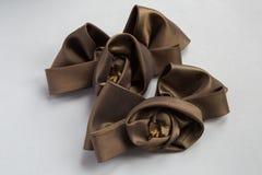 Bruine decoratieve bogen voor het naaien op kleding Royalty-vrije Stock Afbeelding