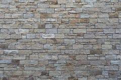 Bruine en grijs gesneden steenmuur stock foto