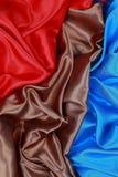 Bruine en rode en blauwe Zijdedoek van golvende abstracte achtergronden Stock Afbeeldingen