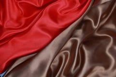 Bruine en rode Zijdedoek van golvende abstracte achtergronden Royalty-vrije Stock Afbeelding