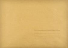 Bruine envelop gemaakt ââof tot gestreept document Stock Foto's
