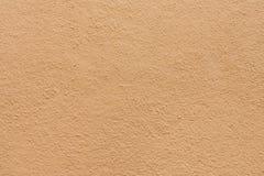 Bruine gipspleistermuur Stock Afbeelding