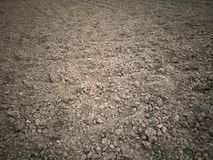 Bruine grondachtergrond Stock Foto