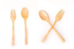 Bruine houten lepels en vork op witte achtergrond Stock Afbeeldingen