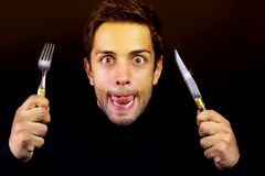 Bruine jonge mens die bereid is te eten Stock Afbeelding