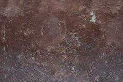 Bruine muurachtergrond met witte delen stock fotografie