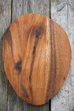 Bruine ovale houten raadsachtergrond Stock Afbeelding