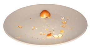 Bruine plaat en crumbs stock foto