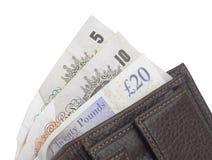 Bruine portefeuille met Britse pondnota's Stock Foto's