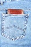 Bruine portefeuille in zak Stock Afbeelding