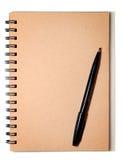 Bruine Spiraalvormige en Zwarte Pen Stock Afbeelding