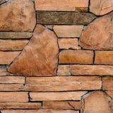 Bruine steenmuur stock afbeeldingen