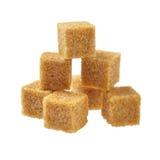 Bruine suiker, een paar stukken. Royalty-vrije Stock Afbeeldingen