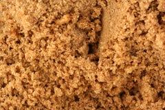 Bruine suikerachtergrond royalty-vrije stock afbeeldingen