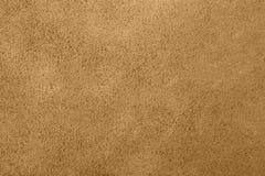 Bruine textuur als achtergrond van pleistermuur Stock Foto's